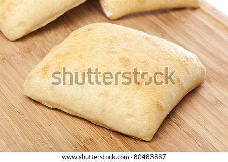 Fresh ciabatta bread against a white background