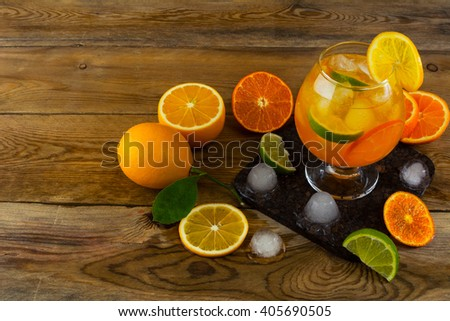 Fresh citrus cocktail on wooden table. Fruit cocktail. Fruit drink. Citrus lemonade. Fruit lemonade. Summer drink  - stock photo