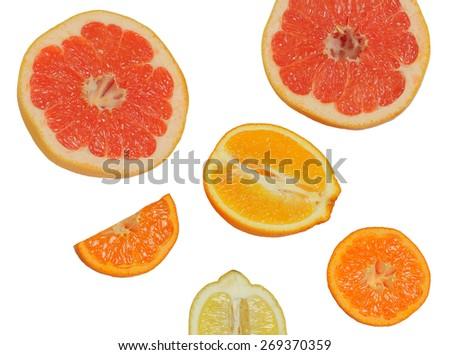 Fresh citrus fruit on white - stock photo