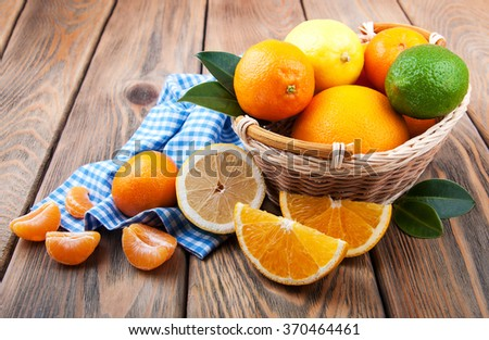 Fresh citrus fruits on a old wooden table