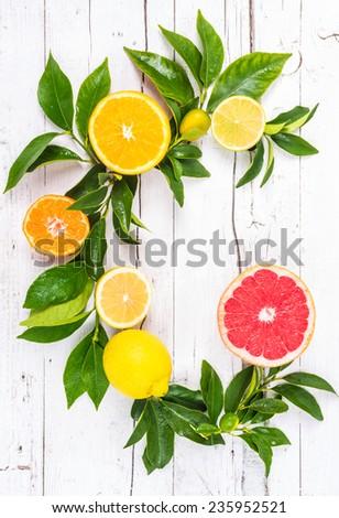 Fresh citrus fruits on white background. Vitamin c fruits still life. - stock photo