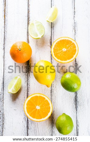 Fresh citrus fruits on white rustic wooden background view from  - stock photo