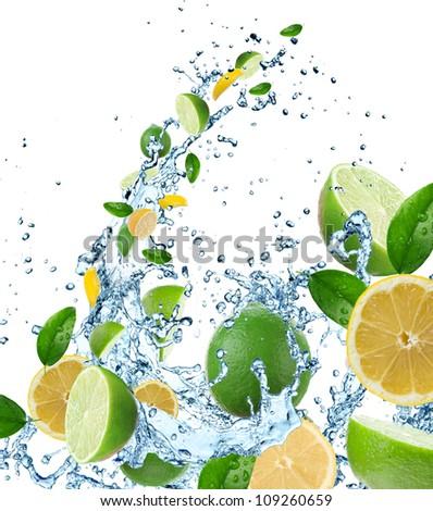 Fresh citruses in water splash - stock photo