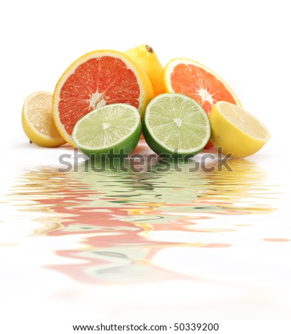 Fresh citruses with water reflection