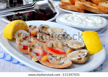 Fresh clams served with lemon - stock photo