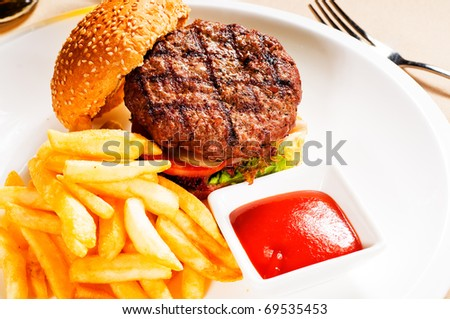 fresh classic american hamburger sandwich with french fries and ketchup sauce on side - stock photo