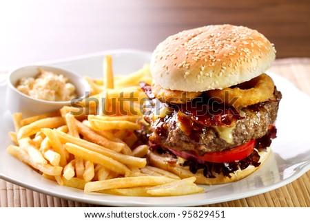 fresh classic american hamburger sandwich with french fries and sauce on side - stock photo