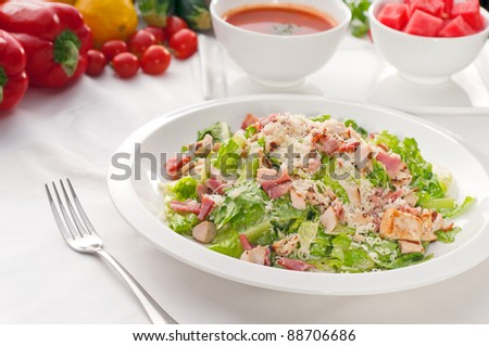 fresh classic caesar salad  served with gazpacho soup,healthy meal , - stock photo