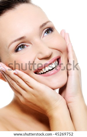 Fresh clean female face with a beauty whitest smile over white background