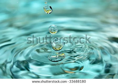 Fresh clear water with reflection of grape. - stock photo
