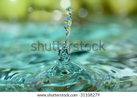 Fresh clear water with reflection of grapes. - stock photo