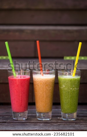 fresh cocktail variations in long glass. Vertical image. - stock photo