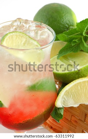 Fresh cocktail with a lime , mint and ice on a white background - stock photo