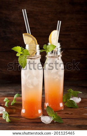 fresh cocktail with grapefruit served in jar - stock photo