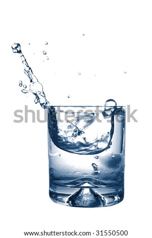 fresh cocktail with splashing water as a cool summer drink - stock photo