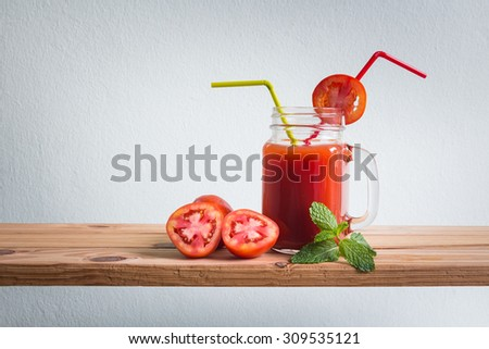 Fresh cocktail with tomato juice on wooden counter bar, rustic style - stock photo
