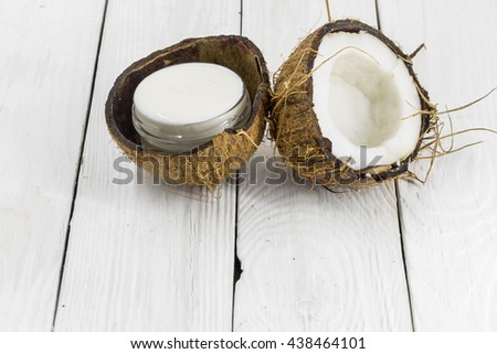 fresh coconut, coconut cream on a wooden white background, environmental product - stock photo