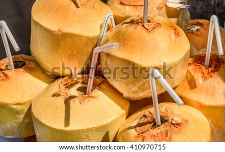 Fresh Coconut drink with a  straw - stock photo