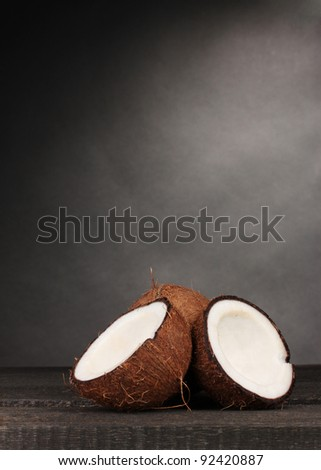Fresh coconut on grey - stock photo
