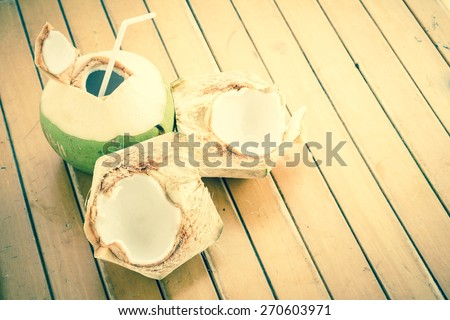 Fresh coconut water drink on table - stock photo
