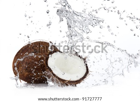 Fresh coconuts in water splash, isolated on white background