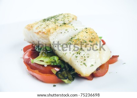 Fresh cod fillet with vegetables - stock photo