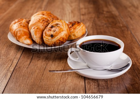 fresh coffee and croissant - stock photo