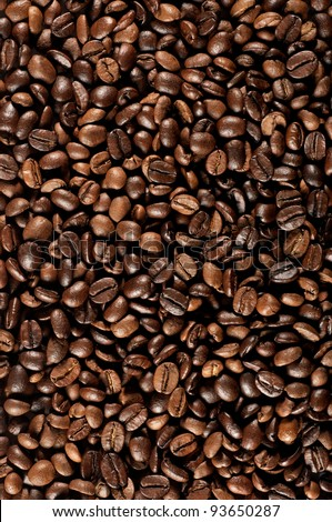 Fresh coffee beans background, vertical composition