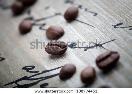 Fresh coffee beans on wooden background, selective focus - stock photo