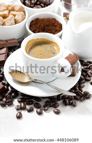 fresh coffee, chocolates and sweets on white background, closeup - stock photo