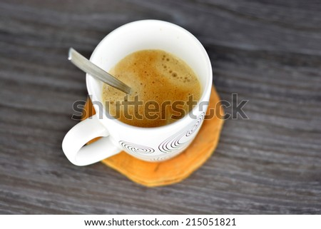 Fresh coffee on a dark wooden background