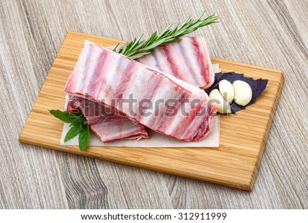 Fresh cold Raw lamb ribs with garlik and pepper - ready for cooking - stock photo