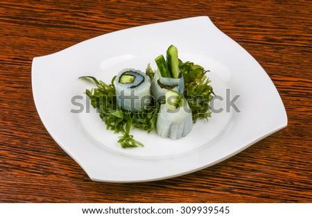 Fresh cold Squid sashimi with cucumber and nori - stock photo