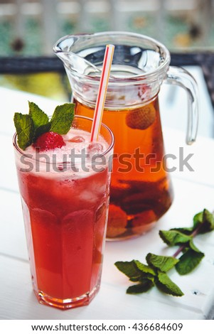 Fresh cold strawberry tea with ice and mint  - stock photo