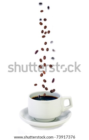Fresh Colombian Coffee Beans Falling Into A Freshly Brewed Cup Of Coffee, Concept For Fresh Brewed Coffee - stock photo
