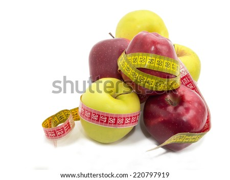 fresh colored apples with a ruler, apple diet