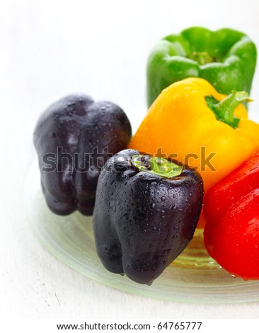fresh colored peppers on white background