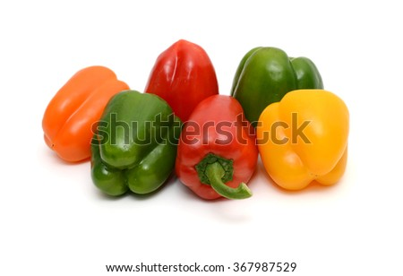 Fresh colorful capsicum or bell peppers on the white background - stock photo