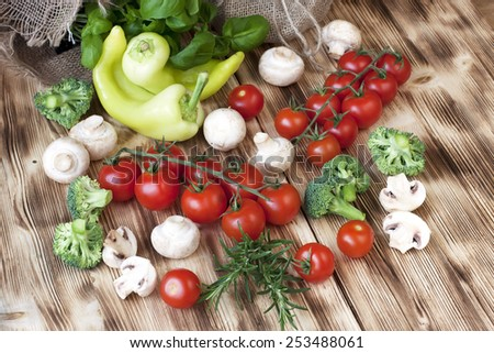 Fresh colorful delicious vegetables on  old wooden table - stock photo
