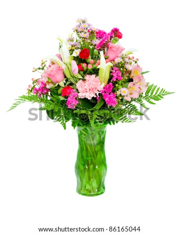 Fresh, colorful professional flower arrangement in green glass vase isolated on white - stock photo