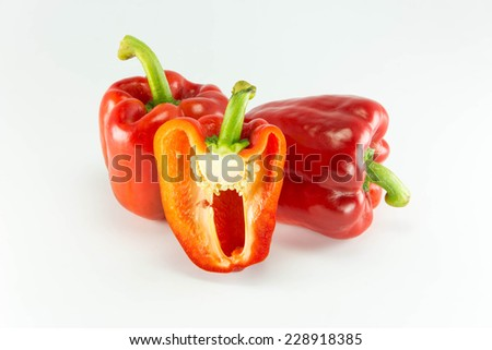 Fresh colorful sweet bell peppers ( capsicum ) on a white background.