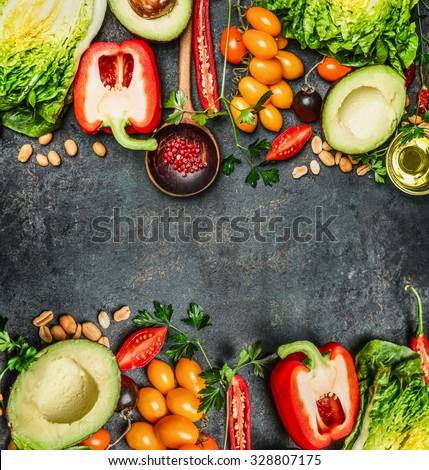 Fresh Colorful Vegetables ingredients for tasty vegan and  healthy cooking or salad making on rustic background, top view, frame. Diet food concept. - stock photo