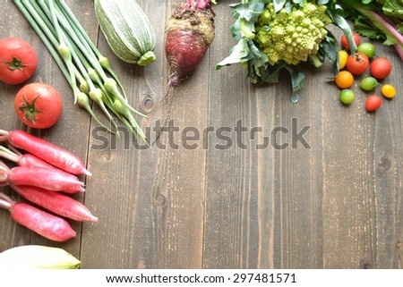 Fresh colorful vegetables on wooden background