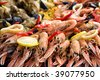 Fresh cooked paella for sale at a street market - stock photo