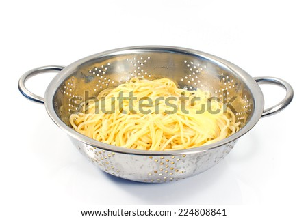Fresh cooked spaghetti in stainless strainer isolated on white   - stock photo