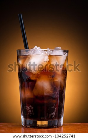 fresh cool glass of cola drink with ice - stock photo