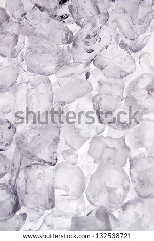 fresh cool ice cube background or wallpaper for summer or winter - stock photo
