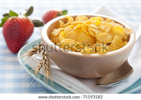 fresh cornflakes in a bowl and strawberries