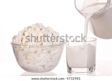 Fresh cottage cheese and milk in glass