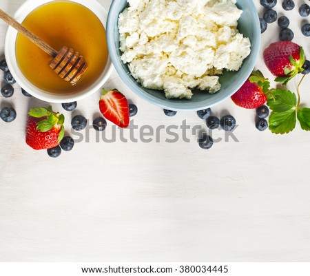 Fresh cottage cheese, honey and berries for healthy eating - stock photo
